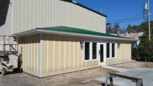 Commercial seamless gutters installed on small warehouse in Myrtle Beach.
