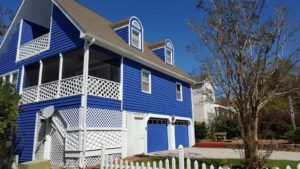 This beach house gets a brand new look with seamless gutters.