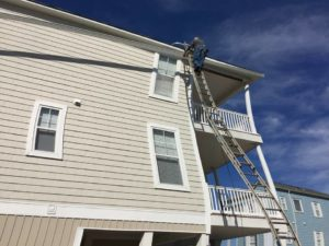 New seamless gutters being installed on a Myrtle Beach beach house.